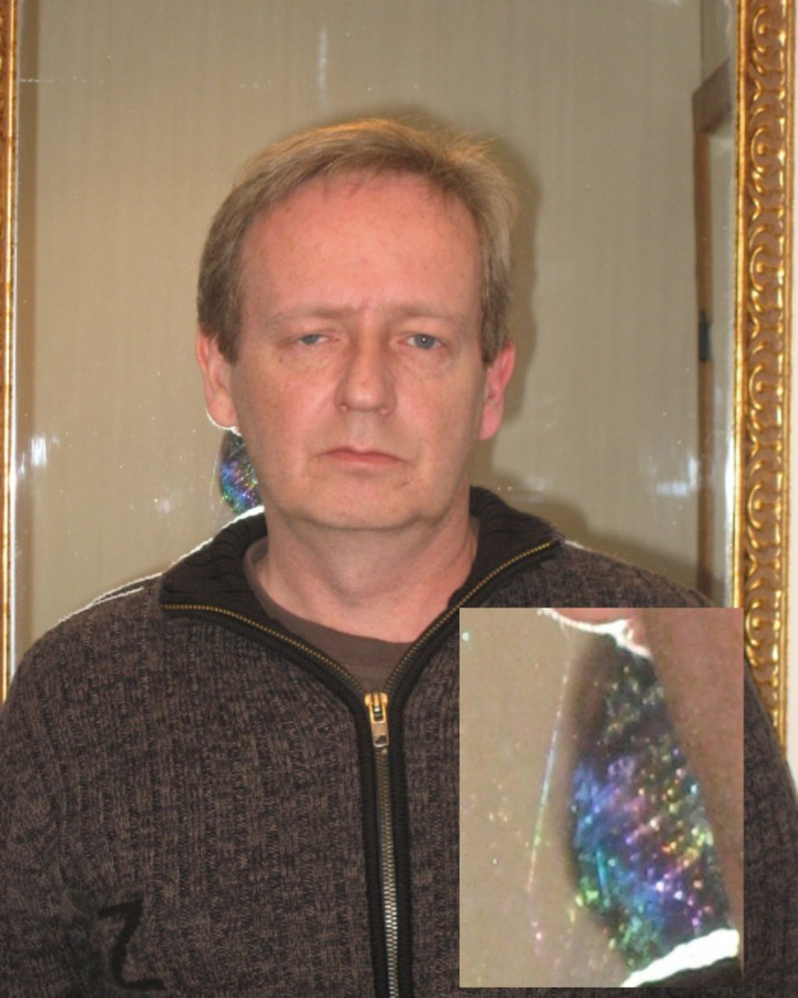 Scrying - medium overshadowed one side of face and crystal - prism manifesting in mirror